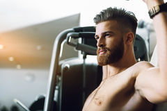 Young confident man in gym Stock Photo