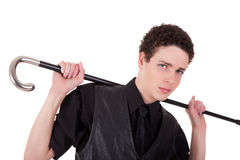 Young confident man holding a cane Royalty Free Stock Photos