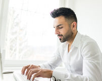 Young confident man working in modern office Royalty Free Stock Photos