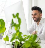 Young confident man working in modern office Stock Photos