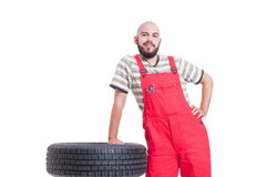 Young confident mechanic waiting and resting Royalty Free Stock Photos