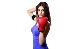 Young confident sport woman standing with boxing gloves Stock Photo