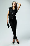Young confident woman in black casual clothes standing Royalty Free Stock Photography