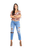 Young confident woman in casual clothes with folded arms looking at camera Royalty Free Stock Photo