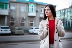 Young confident woman in city stock image
