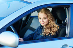 Young confident woman driving a car royalty free stock photography