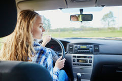 Young confident woman driving a car royalty free stock image