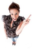 Young confident woman pointing back her left hand Stock Photography