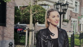 Young confident woman walking in the city streets. stock video