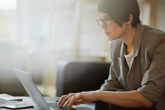 Young Confident Woman Working with Laptop Stock Photography
