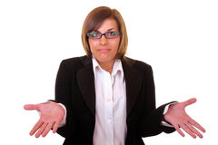 Young confused businesswoman. Young attractive and confused businesswoman on white background Royalty Free Stock Image