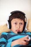 Young confused playing video game Stock Images