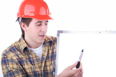 Young construction engineer. Doing a presentation with whiteboard Royalty Free Stock Images