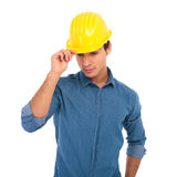 Young construction engineer holding his safety helmet and looks Royalty Free Stock Photography