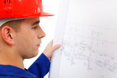 Young construction engineer surveying plans Stock Photo