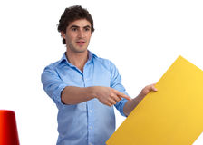 Young construction foreman with yellow sign Royalty Free Stock Image