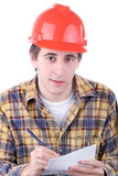 Young construction worker. Taking notes isolated on white Royalty Free Stock Photos