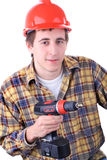 Young construction worker. With cordless drill, isolated on white Royalty Free Stock Photos