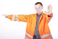 Young construction worker. Pointing right Stock Photos