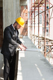 Young Construction Worker With Blueprint Stock Photo