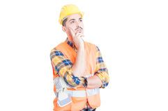 Young construction worker or engineer thinking and looking away Royalty Free Stock Photography