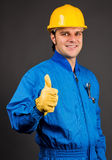 Young construction worker giving thumb up sign Royalty Free Stock Image