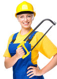 Young construction worker with hacksaw Royalty Free Stock Images