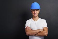 Young construction worker in hard hat Royalty Free Stock Images