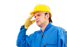 Young construction worker having a headache Stock Photography