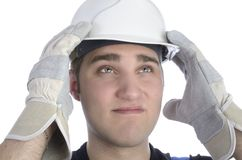 Young construction worker with helmet in sorrow Stock Image