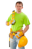 Young construction worker holding level isolated white backgroun Royalty Free Stock Photo