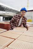 Young Construction Worker Leaning On Tiles Stock Photos