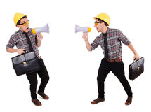 The young construction worker with loudspeaker isolated on white Stock Photo