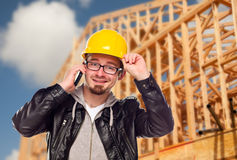 Young Construction Worker on Phone At House Site Stock Photo