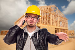 Young Construction Worker on Phone At House Site Royalty Free Stock Photos