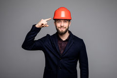 Young construction worker pointed on hard hat stock photos