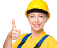 Young construction worker is showing thumb up sign Royalty Free Stock Image