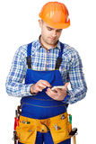 Young construction worker with smartphone Royalty Free Stock Photo