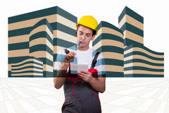 The young construction worker taking notes Stock Image