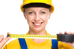 Young construction worker with tape measure Stock Photos