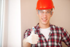 Young construction worker with thumbs up. Shot of young construction worker with thumbs up royalty free stock photography