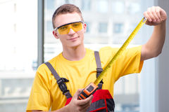 The young construction worker in yellow coveralls stock photos