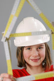 Young constructor. Teenager with measure instrument, house symbol stock image