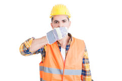 Young constructor covering his mouth with hands Stock Photos