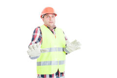 Young constructor looking terrified of something Royalty Free Stock Images