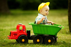 Young constructor sitting in the car. In park Royalty Free Stock Images