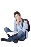 Young contemplative male student sitting on floor. With book. Isolated on white Stock Images