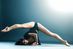 Young contemporary female dancer doing splits Royalty Free Stock Image