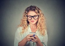 Casual young woman using phone stock photography