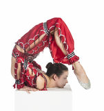A young contortionist,circus performer in a red suit. Acrobat does gymnastic exercises , the isolated image on a white background. Young athletic woman in a red Stock Image